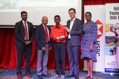 Myskills-students-receiving-cert-from-Deputy-Ceo-of-HSBC-ME-Lim-Eng-Seo